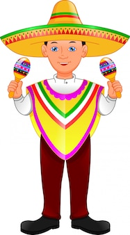 Mexican boy in poncho and sombrero holding maracas