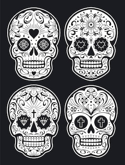 Mexican skulls with patterns. old school tattoo style sugar skulls. white on black version. vector skulls collection.