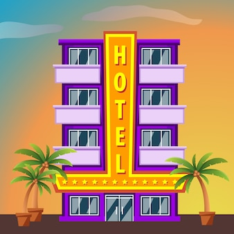 Miami beach hotel building with palm trees at sunset