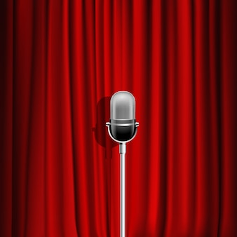 ステージシンボルとしてのマイクと赤いカーテンの現実的な背景