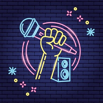 Microphone and speaker in neon style over purple