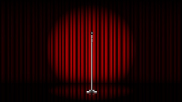 Microphone with stand on stage with red curtain and spot light Premium Vector