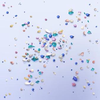 작은 색깔의 입자가있는 미세 플라스틱 배경. 현실적인 그림