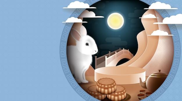 色のパターンの背景にウサギと月の月餅と中秋節