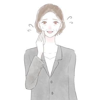 愛想よく笑っているスーツの中年女性。白い背景に。
