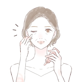 Middle-old woman applying eye cream. on a white background.