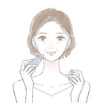 립밤을 바르는 중년 여성. 흰색 배경에.