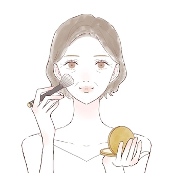 Middle-old woman applying powdery foundation to face with makeup brush. on a white background.