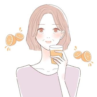オレンジジュースを飲む中年の女性。白い背景に