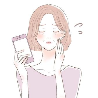 スマートフォンで困っている中年女性。白い背景に。