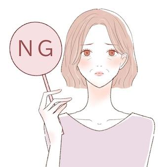 中年女性のngサイン。白い背景に。
