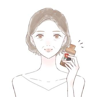 椿油の中年女性。白い背景に。