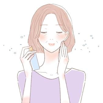 ミストタイプのローションを顔にまぶした中年女性。白い背景に。