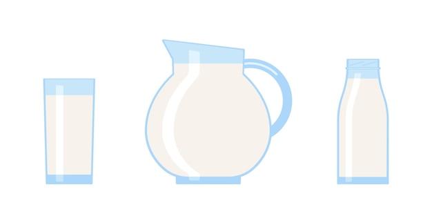 ガラスの水差しとボトルに入ったミルクビタミン入りの新鮮なミルクドリンクミルク飲料