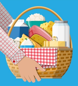 Milk products set in wicker basket with cheese, cottage and butter. dairy food. tradicional fresh farm products.