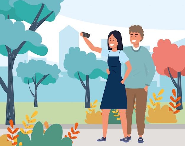 Millennial couple smiling selfie nature