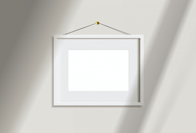 Minimal empty landscape white frame picture   hanging on white wall  with window light and shadow. isolate   illustration.