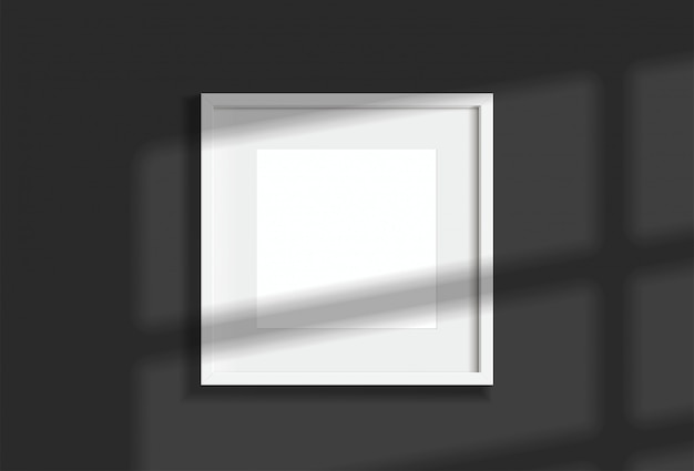 Minimal empty square white frame picture   hanging on dark wall  with window light and shadow. isolate   illustration.