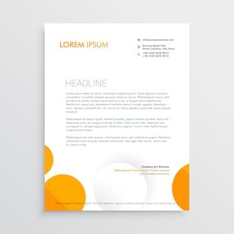 オレンジ色と白い円で最小限のレターヘッドデザイン