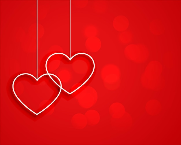 Minimal style hanging hearts on red background