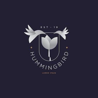 Minimal vintage hummingbird and flower logo