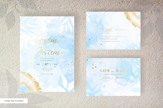 Minimalist wedding invitation card set template with simple floral arrangement and hand painted liquid watercolor