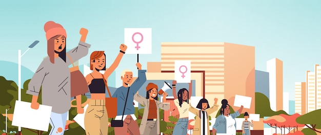 Mix race activists holding placards with female gender sign feminist demonstration girl power movement rights protection women empowerment concept portrait cityscape background horizontal