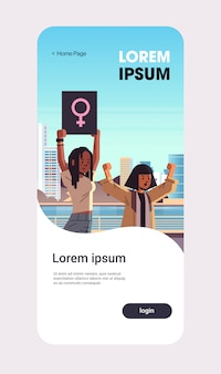 Mix race activists protesting holding placard with female gender sign feminist demonstration girl power movement rights protection women empowerment concept portrait mobile app vertical copy space
