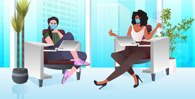 Mix race businesswomen in masks working together in coworking center coronavirus pandemic teamwork concept modern office interior horizontal