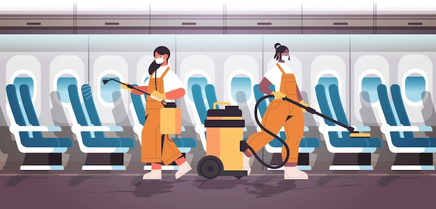 Mix race cleaners in masks disinfecting coronavirus cells in airplane to prevent covid-19 pandemic cleaning service