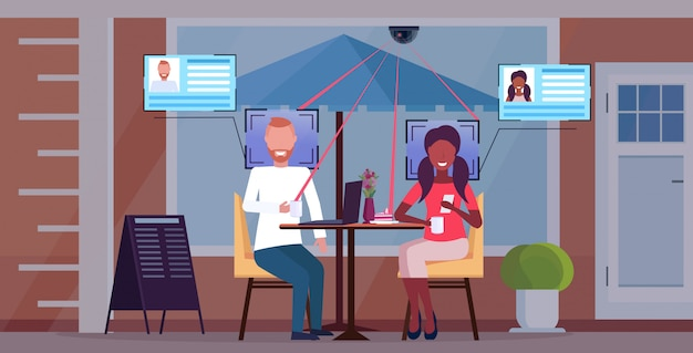 Mix race couple sitting cafe table discussing during meeting customers identification facial recognition concept security camera surveillance cctv system horizontal full length
