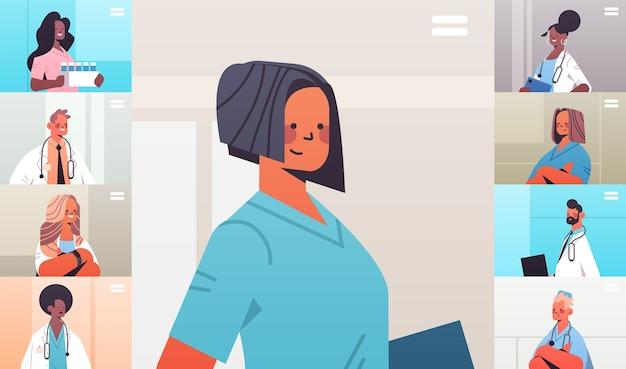 ビデオ会議中に議論しているウェブブラウザウィンドウの混血医師グループ医学ヘルスケアオンラインコミュニケーションの概念水平肖像画ベクトル図