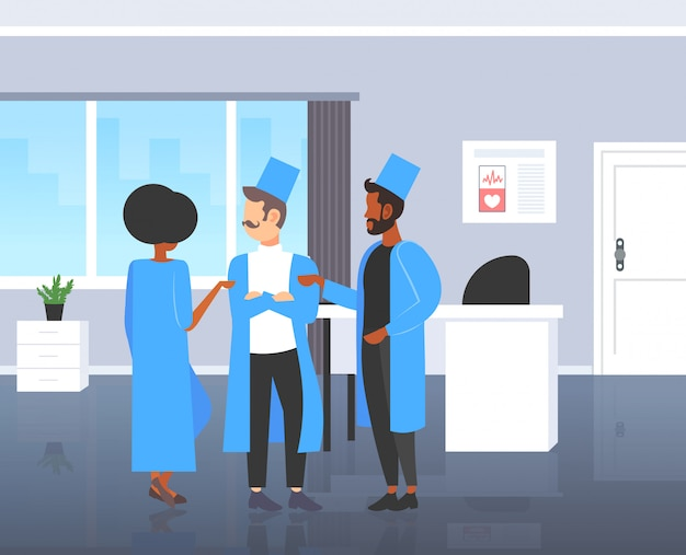 Mix race doctors team discussing during meeting medical staff colleagues in uniform standing together teamwork medicine healthcare concept modern hospital room interior  full length