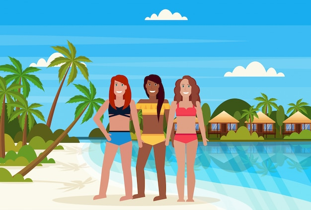 Mix race girls on tropical island with villa bungalow hotel on beach seaside green palms landscape summer vacation flat