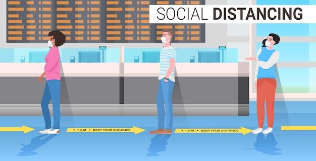 Mix race passengers keeping distance to prevent coronavirus social distancing concept airport terminal interior horizontal