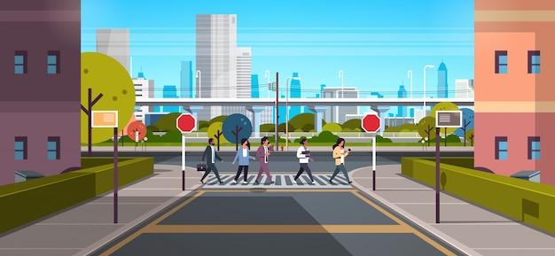 Mix race people going crosswalk