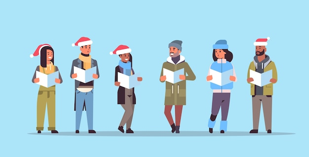 Mix race people reading books merry christmas happy new year holiday celebration concept men women wearing santa hats horizontal full length vector illustration
