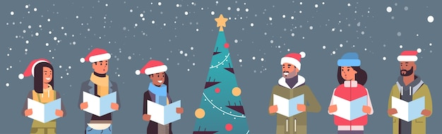 Mix race people reading books merry christmas happy new year holiday celebration concept men women wearing santa hats standing near fit tree horizontal portrait vector illustration