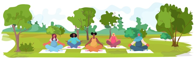 Mix race pregnant women doing yoga fitness exercises training healthy lifestyle concept girls meditating in park landscape background