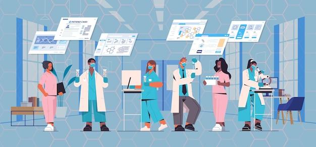 遺伝子工学診断をテストする実験室で実験を行う試験管研究者チームでdnaを扱うマスクでレース科学者を混ぜる