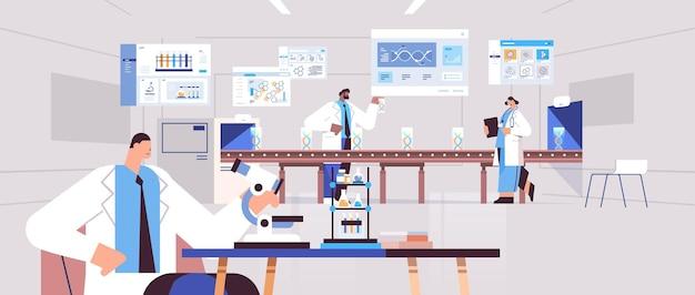実験室のdna検査遺伝子工学診断で微生物学研究を行う顕微鏡研究者チームを探している混合レース科学者