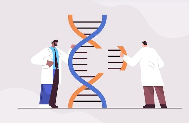 遺伝子診断をテストする実験室で実験を行うdna研究者と協力する混血科学者