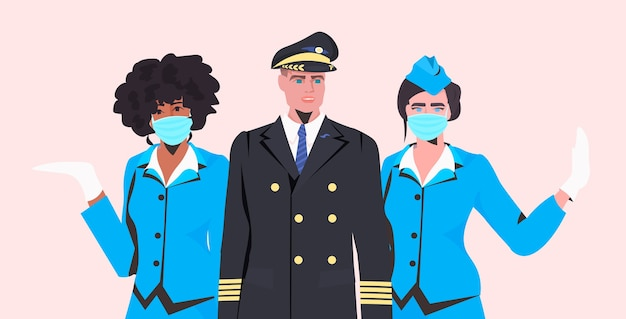 Mix race stewardesses with man pilot in uniform standing together aviation concept portrait horizontal