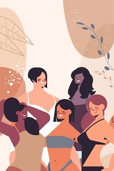 Смешанные расы женщины разного роста, фигуры и размера, стоящие вместе, любят свое тело, концепция девушки в купальниках портрет вертикальная векторная иллюстрация