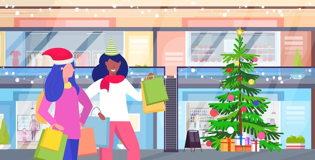 Mix race women in santa hat carrying shopping bags merry christmas happy new year winter holidays celebration