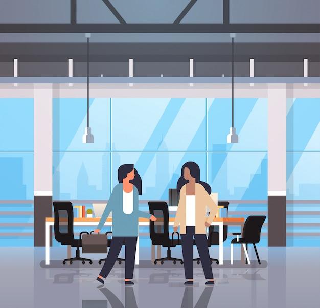 Mix race women teamwork communication concept businesswomen couple working meeting modern office interior full length cartoon characters flat