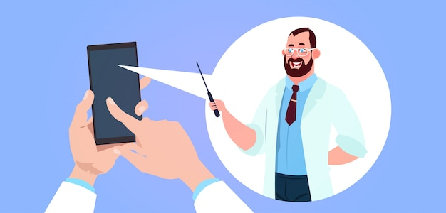 Mobile medicine app with hand holding smart phone over male doctor