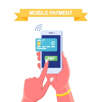 Mobile phone with credit or debit card. online payment, security transaction. internet banking app
