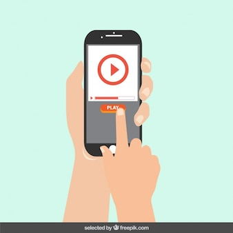 Mobile phone with play button on the screen Free Vector