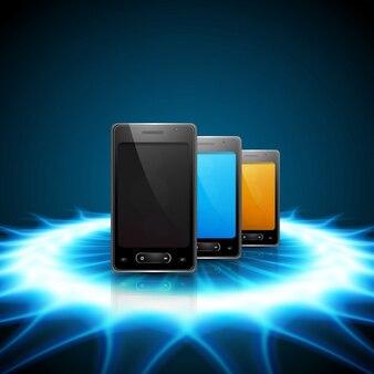 Мобильные телефоны на фоне блестящей